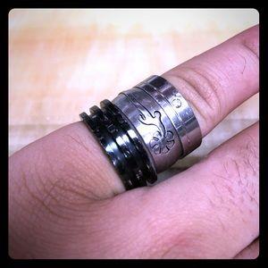 2 silver one black rings